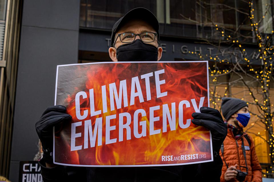 MANHATTAN, NEW YORK, UNITED STATES - 2021/03/03: Participant seen holding a sign at the protest. Climate activists with Stop the Money Pipeline held a rally in midtown Manhattan first at BlackRocks HQ and then march to JP Morgan Chase HQ, -two of the worlds biggest funders of climate destruction in their opinion- to urge the two companies to end their support for the dangerous proposed Line 3 pipeline project, and stop funding fossil fuels and forest destruction. (Photo by Erik McGregor/LightRocket via Getty Images)