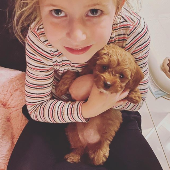 Sonia Kruger's daughter Maggie with a puppy