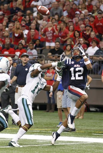 Mississippi wide receiver Donte Moncrief (12) reaches for a touchdown pass in front of Tulane cornerback Jordan Batiste (14) the first half of an NCAA college football game in New Orleans, Saturday, Sept. 22, 2012. (AP Photo/Bill Haber)