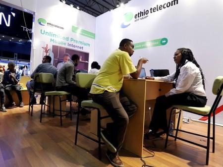 FILE PHOTO: Customers receive assistance from a staff member at an Ethio Telecom branch in Addis Ababa
