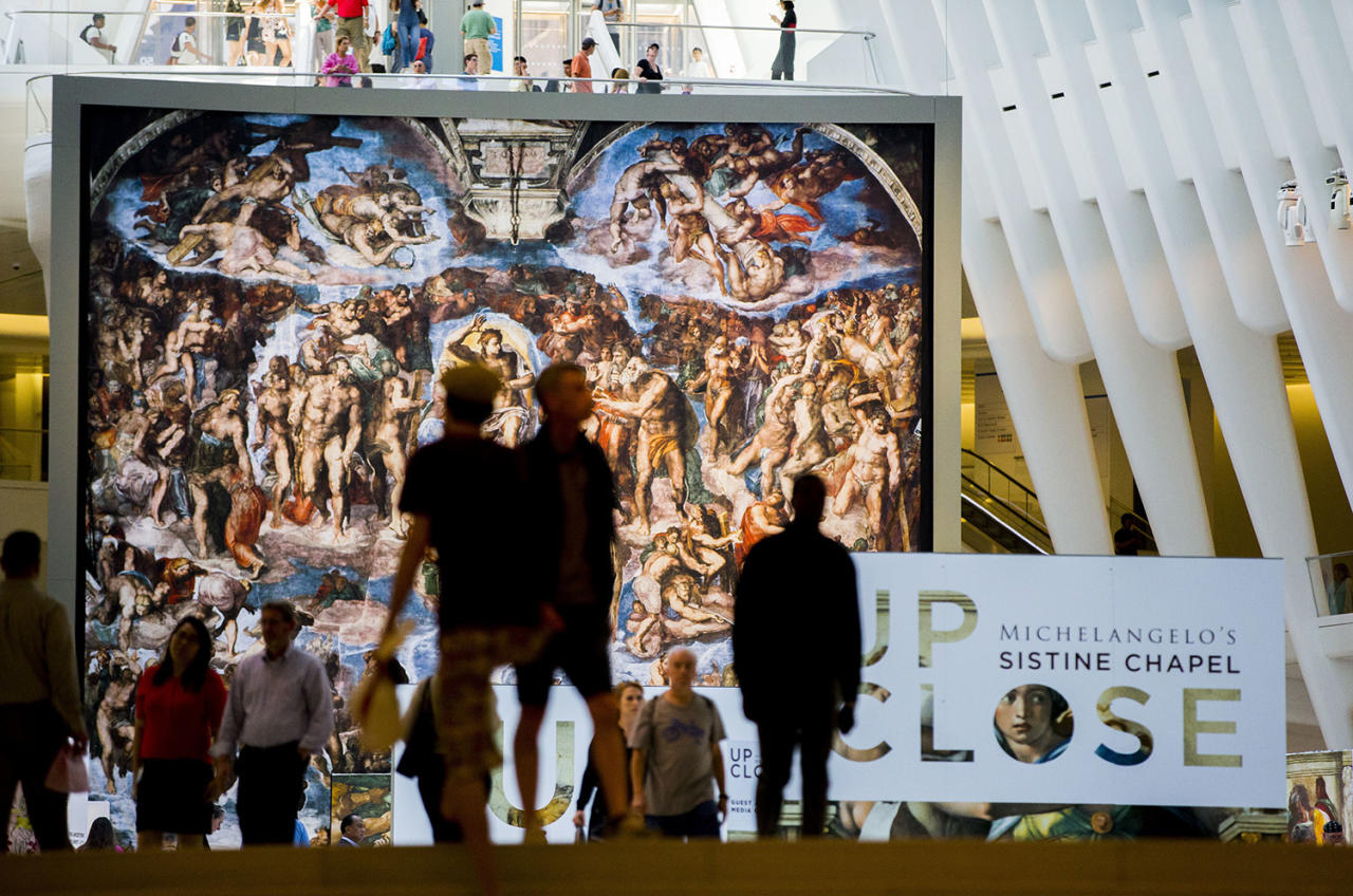 "<p>""The Last Judgement"" stands above ""Up Close: Michelangelo's Sistine Chapel"" re-creation exhibit at the Oculus at Westfield World Trade Center in New York. The exhibit features 34 reproductions, including ""The Creation of Adam."" (AP Photo/Michael Noble Jr.) </p>"