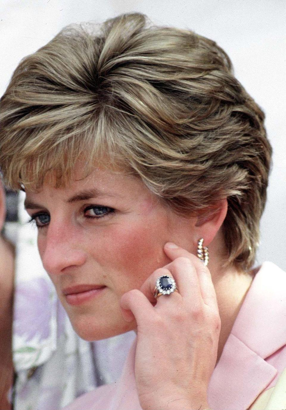 "<p>The ring was a hit with the public and caused a huge trend in colored stone engagement rings. The ring, set in white gold, <a href=""https://www.goodhousekeeping.com/life/a22727712/princess-diana-engagement-ring/"" rel=""nofollow noopener"" target=""_blank"" data-ylk=""slk:featured an 12-carat oval Ceylon sapphire"" class=""link rapid-noclick-resp"">featured an 12-carat oval Ceylon sapphire</a> with cluster diamonds around it. </p>"