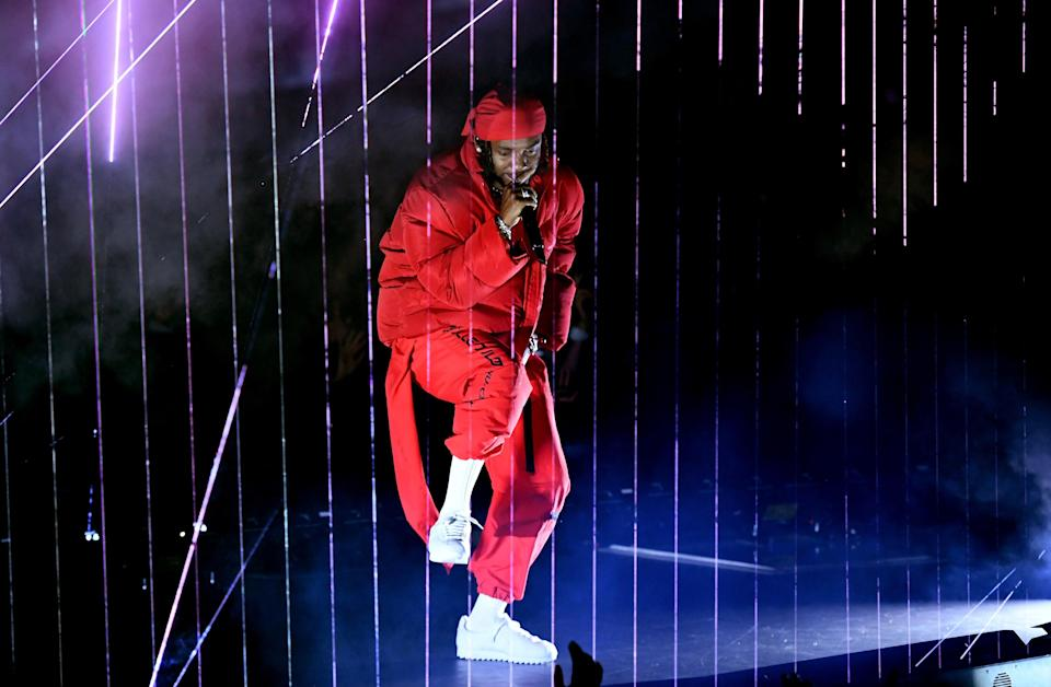 Kendrick Lamar performs onstage surrounded by lazor beams during the 2017 MTV Video Music Awards at The Forum on August 27, 2017 in Inglewood, California.