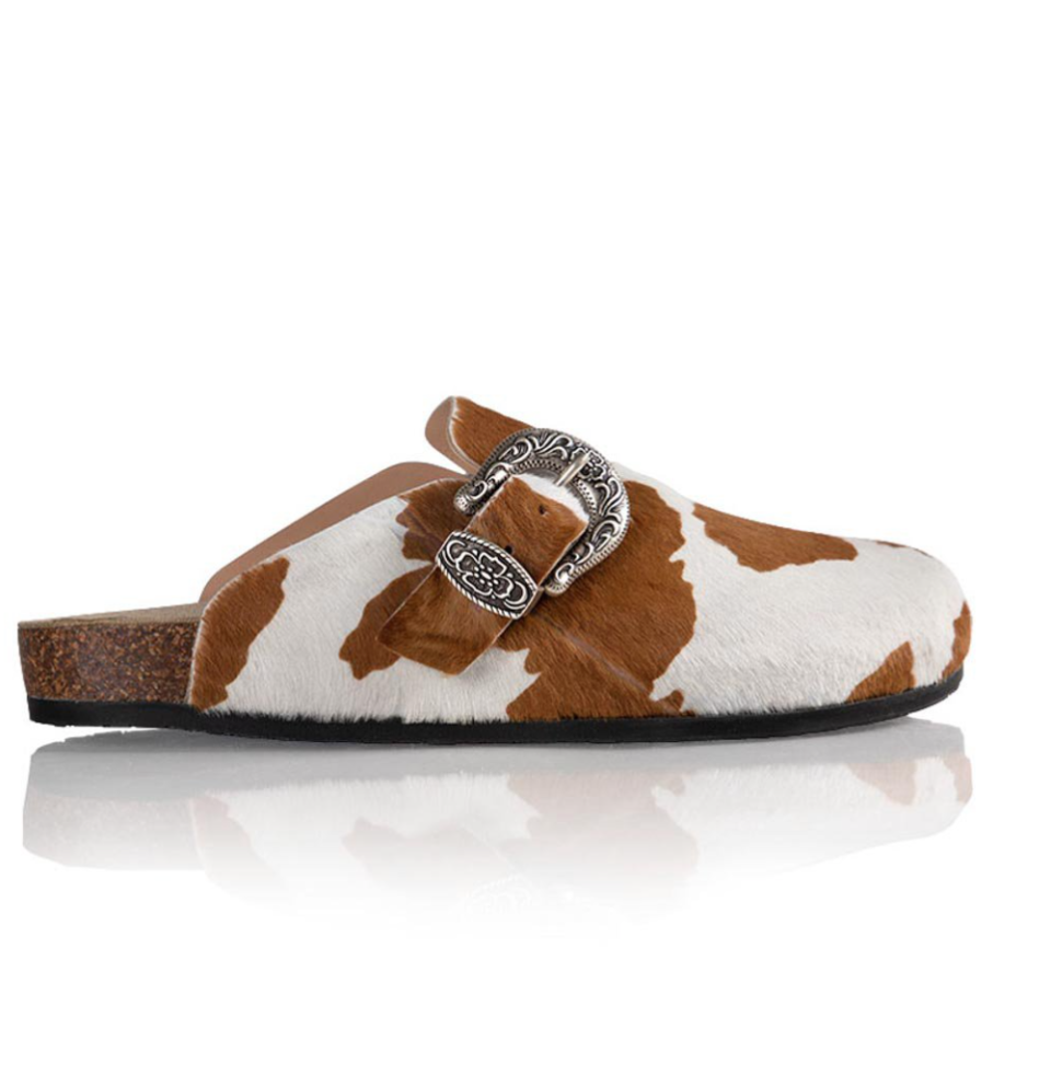 """<p><strong>Brother Vellies</strong></p><p>brothervellies.com</p><p><strong>$395.00</strong></p><p><a href=""""https://brothervellies.com/collections/all/products/greg-shoe"""" rel=""""nofollow noopener"""" target=""""_blank"""" data-ylk=""""slk:Shop Now"""" class=""""link rapid-noclick-resp"""">Shop Now</a></p><p>If the rise of western boots hasn't cured your appetite for the wild, wild west, you're in luck. We've gone through a wide variety of animal prints from zebra to cheetah and have landed on cow print for a look that is just as peaceful and friendly as the farm animal. </p>"""