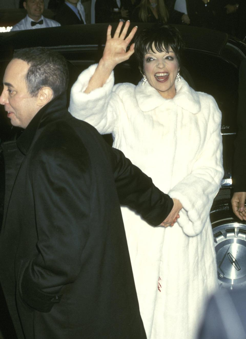<p>Liza wore a silk Bob Mackie dress underneath that white furry coat for her extravagant 2002 nuptials to music promoter David Gest. The ceremony took place at the Marble Collegiate Church in NYC and the day reportedly cost over $3 million.</p>