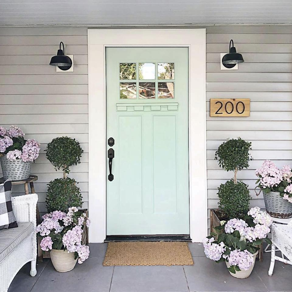 """<p>Kay Volmar proves a little goes a long way when it comes to farmhouse paint colors. She used <a href=""""https://www.sherwin-williams.com/homeowners/color/find-and-explore-colors/paint-colors-by-family/SW6470-waterscape"""" rel=""""nofollow noopener"""" target=""""_blank"""" data-ylk=""""slk:this bright, breezy blue"""" class=""""link rapid-noclick-resp"""">this bright, breezy blue</a> to create a welcoming entry to her charming Florida cottage. See it <a href=""""https://www.southernliving.com/home/decor/kay-volmar-florida-cottage?slide=444ac195-abc0-4073-921e-82a9eb90432b#444ac195-abc0-4073-921e-82a9eb90432b"""" rel=""""nofollow noopener"""" target=""""_blank"""" data-ylk=""""slk:here."""" class=""""link rapid-noclick-resp"""">here.</a></p>"""