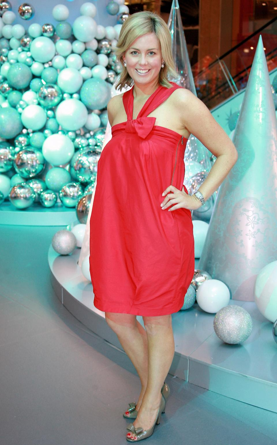 Channel 7 Weekend Sunrise c-host Samantha Armytage poses in a red dress at the Santa arrival at Bondi Junction Westfield on November 16, 2007 in Sydney, Australia.