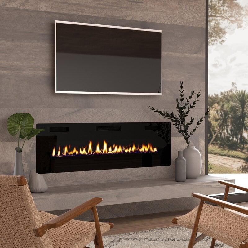 <p>Get warm by this <span>Adriean Wall Mounted Electric Fireplace</span> ($370, originally $473).</p>