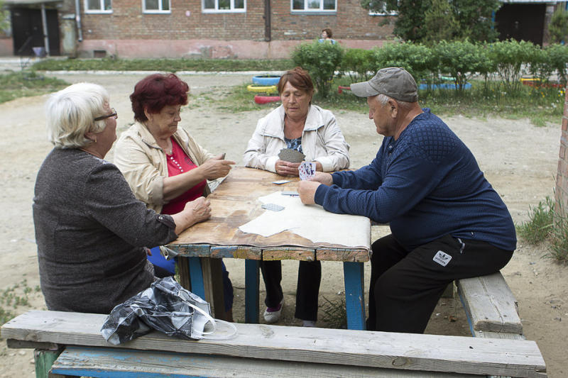 The residents of Meget get together to play cards.