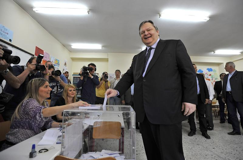 Leader of the Greek Socialist PASOK party Evangelos Venizelos casts his ballot inside a polling station in Thessaloniki, northern Greece Sunday May 6, 2012. Greeks cast ballots on Sunday in their most critical _ and uncertain _ election in decades, with voters set to punish the two main parties that are being held responsible for the country's dire economic straits. (AP Photo/Nikolas Giakoumidis)