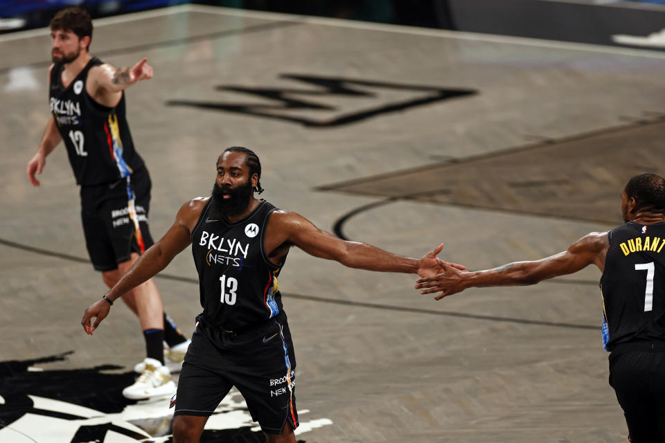 Brooklyn Nets guard James Harden (13) with Kevin Durant against the Boston Celtics in the second half of Game 5 during an NBA basketball first-round playoff series, Tuesday, June 1, 2021, in New York. (AP Photo/Adam Hunger)