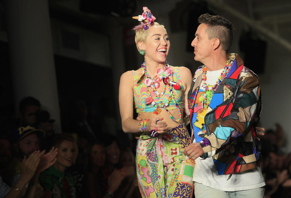US pop star Miley Cyrus and designer Jeremy Scott walk the runway during his Spring/Summer 2015 collection at New York Fashion Week
