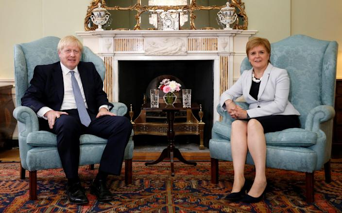 Boris Johnson poses for a photograph with Scotland's First Minister Nicola Sturgeon at Bute House - Duncan McGlynn/Reuters