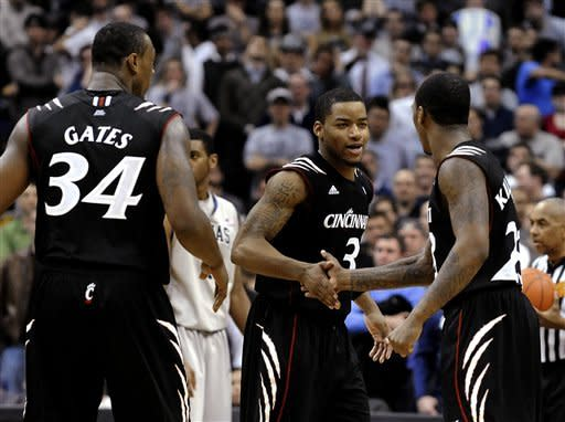 Cincinnati's Dion Dixon (3) and Sean Kilpatrick, right, congratulate each other during Cincinnati's 68-64 win over Georgetown in an NCAA college basketball game, Monday, Jan. 9, 2012, in Washington. (AP Photo/Richard Lipski)