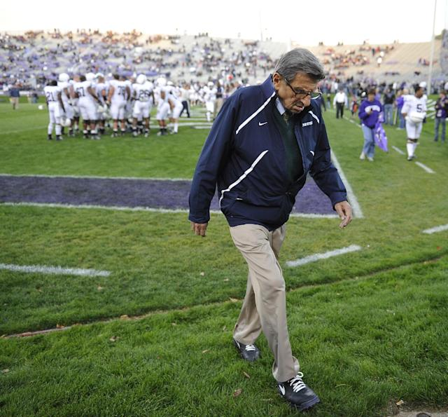 "FILE - In this Oct. 22, 2011 file photo, Penn State coach Joe Paterno walks off the field after warmups before an NCAA college football game against Northwestern in Evanston, Ill. NCAA president Mark Emmert says he isn't ruling out the possibility of shutting down the Penn State football program in the wake of the Jerry Sandusky child sex abuse scandal. In a PBS interview Monday night, July 16, 2012, he said he doesn't want to ""take anything off the table"" if the NCAA determines penalties against Penn State are warranted. (AP Photo/Jim Prisching, File)"