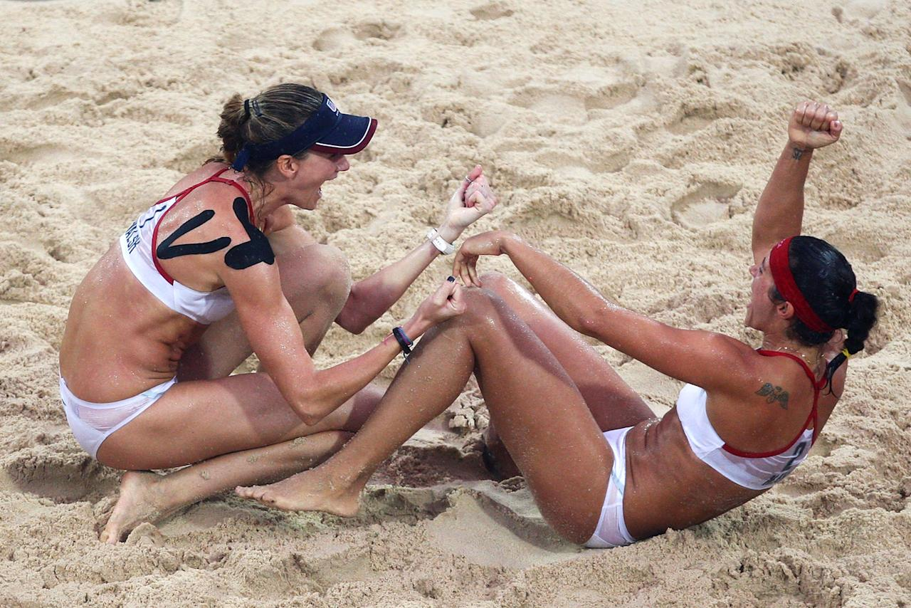 (L-R) Kerri Walsh and Misty May-Treanor of the United States celebrate winning match point against Wang Jie and Tian Jia of China in the women's beach volleyball gold medal match held at the Chaoyang Park Beach Volleyball Ground during Day 13 of the Beijing 2008 Olympic Games on August 21, 2008 in Beijing, China.