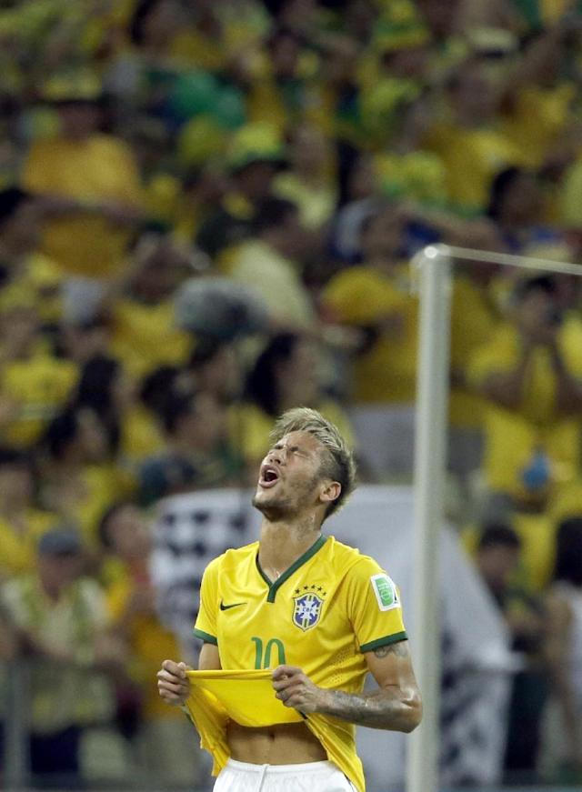 Brazil's Neymar reacts after missing a chance to score during the World Cup quarterfinal soccer match between Brazil and Colombia at the Arena Castelao in Fortaleza, Brazil, Friday, July 4, 2014. (AP Photo/Hassan Ammar)