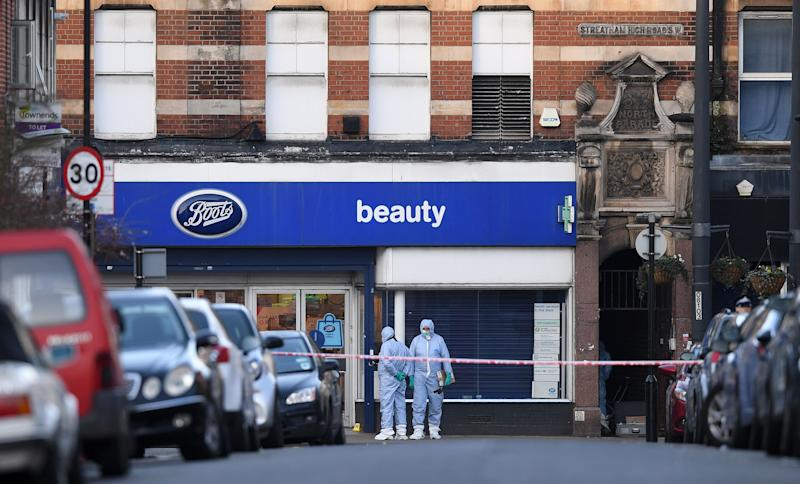 "Police forensic officers work outside of a Boots store on Streatham High Road in south London on February 3, 2020, after a man was shot dead by police on February 2, following reports he had stabbed two people. - A man wearing a ""hoax device"" shot dead by police in London Sunday after stabbing two people had recently been released from prison for previous terrorism offences, British media reported. The suspect, Sudesh Amman, was released last month after serving around half of an approximate three-year sentence for disseminating terrorist material, according to multiple reports. (Photo by DANIEL LEAL-OLIVAS / AFP) (Photo by DANIEL LEAL-OLIVAS/AFP via Getty Images)"