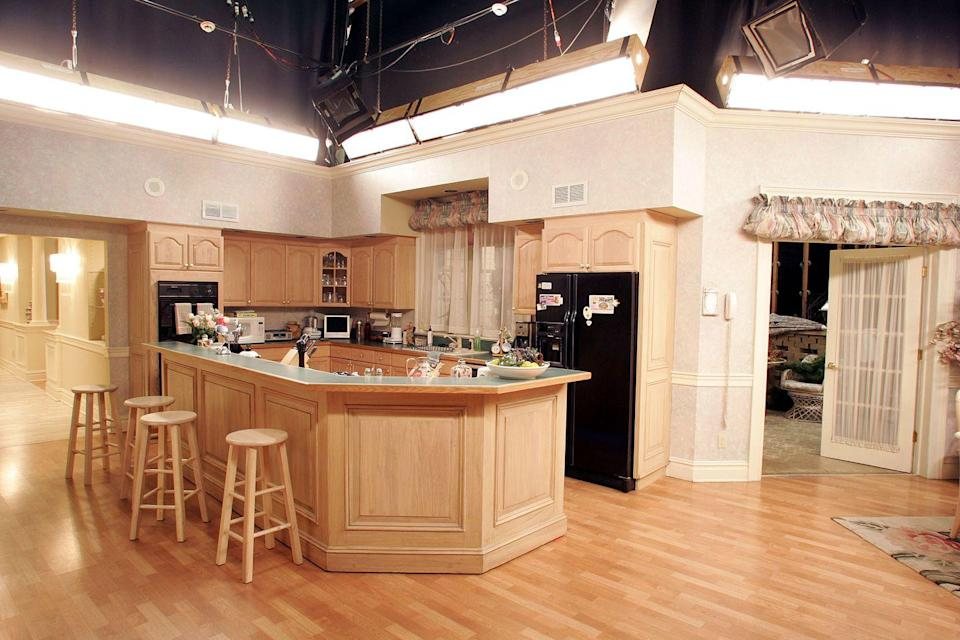 <p>From its green countertops to the black refrigerator, the family's kitchen was very on-trend for the time.</p>