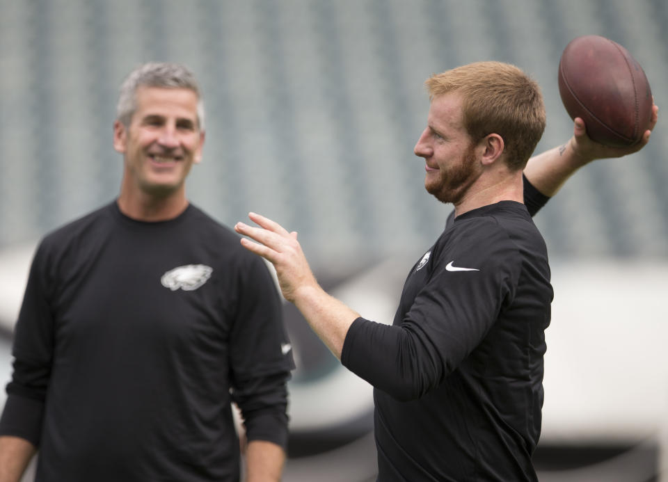 PHILADELPHIA, PA - SEPTEMBER 1: Carson Wentz #11 of the Philadelphia Eagles warms up in front of offensive coordinator Frank Reich prior to the game against the New York Jets at Lincoln Financial Field on September 1, 2016 in Philadelphia, Pennsylvania. The Eagles defeated the Jets 14-6. (Photo by Mitchell Leff/Getty Images)