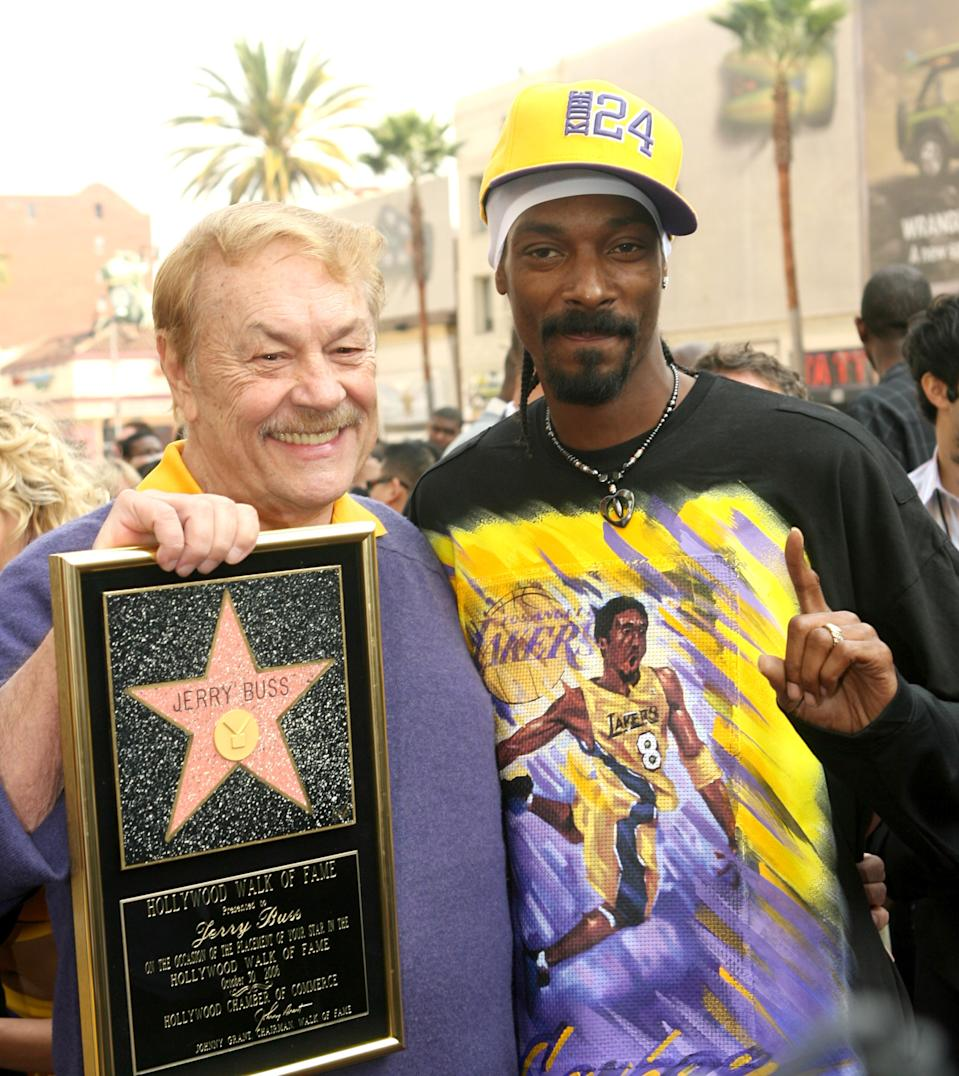 Jerry Buss and Snoop Dogg during Jerry Buss Honored with a Star on the Hollywood Walk of Fame at Hollywood Blvd. in Hollywood, CA, United States. (Photo by M. Phillips/WireImage)