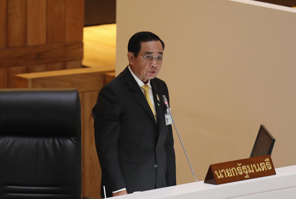 Thailand's Prime Minister Prayuth Chan-ocha delivers a speech during the special session at the parliament house in Bangkok, Thailand, Monday, Oct. 26, 2020. Thailand's Parliament began a special session Monday that was called to address tensions as pro-democracy protests draw students and other demonstrators into the streets almost daily demanding the prime minister's resignation. (AP Photo/Sakchai Lalit)