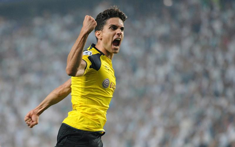 In this file photo dated Wednesday, Sept. 14, 2016, Dortmund's Marc Bartra celebrates after scoring during the Champions League Group F soccer match between Legia Warsaw and Dortmund - Credit: AP