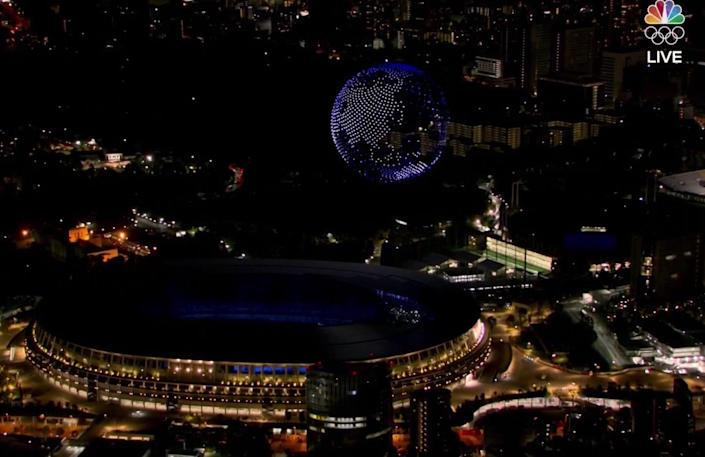Drones form the Earth above the Olympic Stadium.