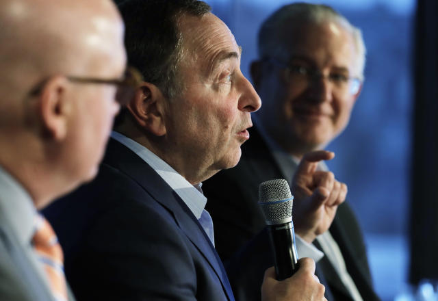 NHL Commissioner Gary Bettman, center, joins Deputy Commissioner Bill Daly, left, and Tod Leiweke, right, president and CEO of the Seattle Hockey Partners group, Wednesday, Jan. 9, 2019, during a news conference in Seattle. Bettman said the NHL has promised Seattle it will host the hockey All-Star Game within its first seven seasons. (AP Photo/Ted S. Warren)