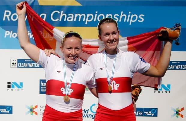 Canada's Caileigh Filmer, left, and Hillary Janssens captured gold in the women's pair event at the 2018 world championship.  (Darko Vojinovic/Associated Press - image credit)