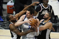 Los Angeles Clippers forward Kawhi Leonard, left, and forward Nicolas Batum, right, defend against Dallas Mavericks center Boban Marjanovic (51) during the third quarter of Game 7 of an NBA basketball first-round playoff series Sunday, June 6, 2021, in Los Angeles, Calif. (AP Photo/Ashley Landis)