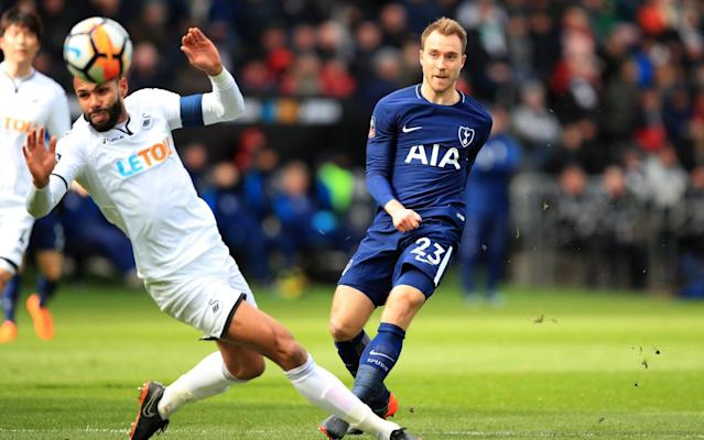 """According to the Mauricio Pochettino world view, it is the """"process"""" that matters most, rather than a single moment of triumph. The journey, his thinking goes, is more than important than the final destination. By that logic, we can safely deduce that Pochettino will have enjoyed his side's performance here, against a thoroughly outclassed Swansea City, just as much as the comprehensive scoreline. This was an afternoon, and a Tottenham showing, that could be savoured in its purest sense, rather than because of what it means in their search for a trophy, or what it shows they can do without the injured Harry Kane. This is not to belittle the importance of reaching a second consecutive FA Cup semi-final, or the significance of attacking so fluidly without their top scorer. It is more to marvel at the quality they showed in these 90 minutes, the ease with which they savaged their opponents and, above all, the brilliance of Christian Eriksen. One of only four players to keep his place in the side from last week's thrashing of Bournemouth, Eriksen was at his surgical best against a Swansea side that was ripe for slicing. A master of angles and movement, he drifted and schemed, passed and moved, slowed it down and sped it up. He also scored, twice, from outside the penalty area. Joining him on the scoresheet was Erik Lamela, another who was able to float around south Wales at will, while there were similarly impressive performances in attack from the likes of Lucas Moura and Son Heung-Min. Even Moussa Sissoko, playing in the centre of midfield, did not look out of place. The only sour note for the visitors was another unwelcome intervention from the dreaded video assistant referee, which Pochettino branded a """"nightmare"""" after Son was denied a goal by a contentious offside decision. """"We are going to have a massive problem for the future,"""" Pochettino said, a day after Fifa confirmed the system will be used at this summer's World Cup. How Dele Alli went from borrowed boots t"""