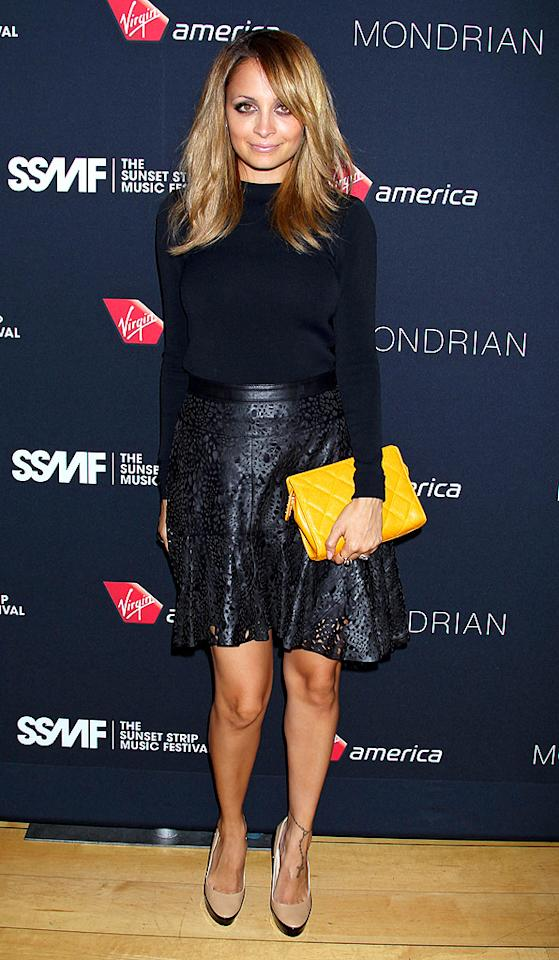 "We love everything about this look provided by Nicole Richie, from her shiny locks to her Jimmy Choo ""Sepia"" heels. Everything in-between -- a Mugler blouse, Winter Kate laser-cut leather skirt, and mustard Chanel clutch -- was also on-point. What's your favorite element of this outfit? If we had to choose just one, we'd probably go with the shoes. (8/18/2012)<br><br><a target=""_blank"" href=""http://omg.yahoo.com/news/richie-eyes-sustained-success-impulse-174150364.html"">Richie eyes sustained success through Impulse</a>"