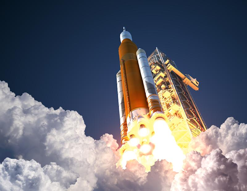 A rocket taking off from a launchpad.