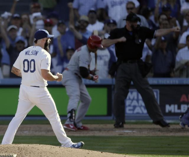 Los Angeles Dodgers relief pitcher Brian Wilson reacts after getting St. Louis Cardinals' Carlos Beltran to strike out during the eighth inning of Game 5 of the National League baseball championship series, Wednesday, Oct. 16, 2013, in Los Angeles. (AP Photo/Chris Carlson)