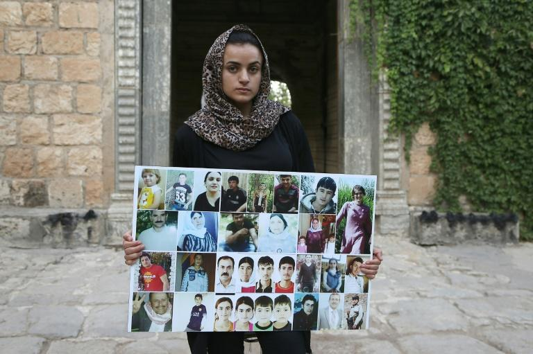 Yazidi woman Ashwaq Haji, 19, who escaped from captivity by the Islamic State group, remembers five brothers and a sister as well as other fellow villagers who are still missing since their capture