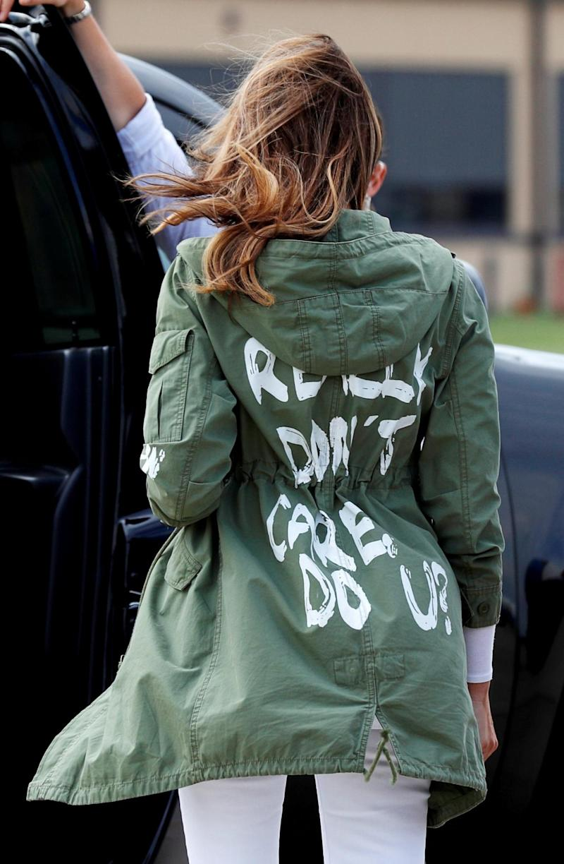 U.S. first lady Melania Trump walks from her airplane to her motorcade wearing a Zara design jacket with the phrase