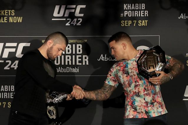 Khabib Nurmagomedov and Dustin Poirier shake hands during a UFC 242 news conference at Hotel Cafe Royal on June 12, 2019 in London, England. (Getty Images)