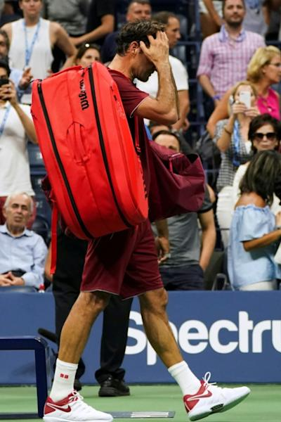 Roger Federer walks off court after losing to Australian John Millman in the fourth round of the US Open on Monday