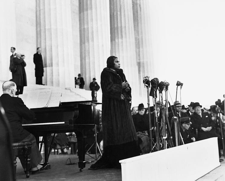 FILE - This April 9, 1939 file photo shows singer Marian Anderson performing on the steps of Washington's Lincoln Memorial on Easter Sunday after she had been refused permission to perform in Washington's Constitution Hall by the hall's owners, the Daughters of the American Revolution. For the first time, Marian Anderson's orange-and-black blouse and skirt ensemble that she wore during her historic performance on the Lincoln Memorial steps 75 years ago will go on display at the Smithsonian. Anderson was a groundbreaking opera singer but was kept out of Washington's Constitution Hall because she was black, and Eleanor Roosevelt invited her to perform at the Lincoln Memorial instead. The concert attire is part of a collection being donated to the National Museum of African American History and Culture by a member of Anderson's extended family to mark the anniversary of Anderson's concert on Wednesday. It will be displayed beginning Tuesday and will remain on view until September. (AP Photo, File)