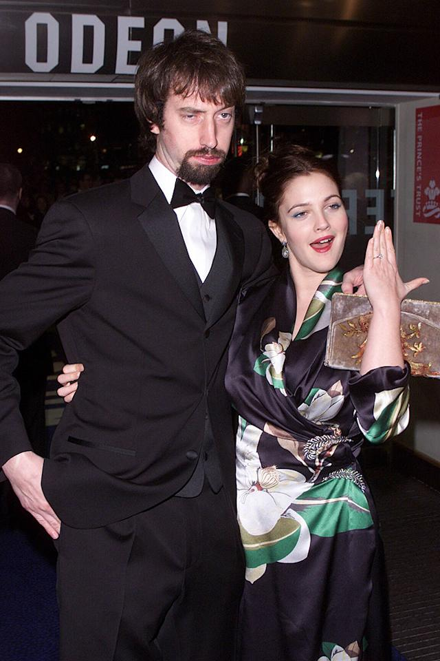 "The world let out a collective ""Huh?"" when Drew Barrymore began dating goofball comedian Tom Green in 2000. The odd couple repeatedly joked that they had been secretly married, and then finally made it official in the South Pacific in March 2001. But just six months later, Green filed for divorce from Barrymore, whose first marriage to a bartender in 1994 lasted a mere 19 days. A decade later, the actress is engaged again, this time to art consultant Will Kopelman."