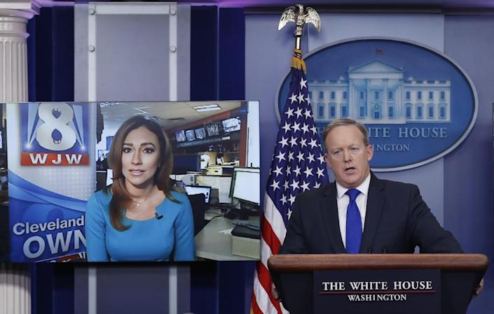 White House press secretary Sean Spicer answers a question from Natalie Herbick of FOX 8 in Cleveland by using Skype during the daily news briefing at the White House, in Washington, Wednesday, Feb. 1, 2017. (AP Photo/Carolyn Kaster)