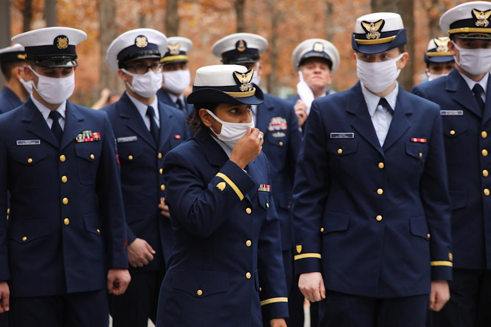 NEW YORK CITY - NOVEMBER 11: Members of the U.S. Coast Guard honor veterans killed in the attacks on September 11 at the memorial at Ground Zero on Veterans Day on November 11, 2020 in New York City. The annual parade in New York, which draws thousands of veterans and spectators from around the country and world, was held as a virtual event this year due to COVID-19. Despite the pandemic restrictions, veterans found numerous ways to honor those that served their country in the armed forces.   (Photo by Spencer Platt/Getty Images)