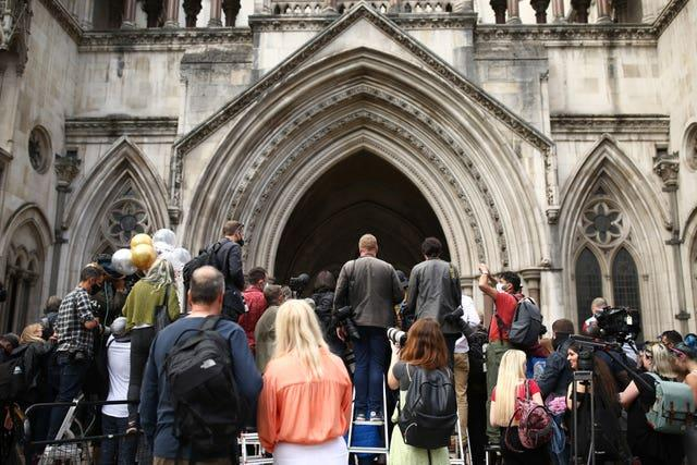 Media outside the High Court during the case