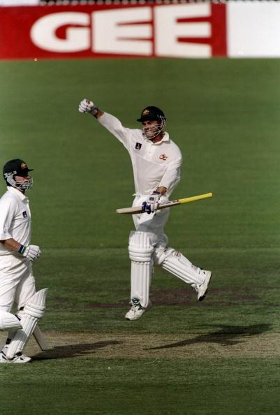 11 Dec 1998:  Justin Langer of Australia celebrates his century during  the Third Ashes Test against England at the Adelaide Oval in Adelaide, Australia. Australia retained the Ashes. \ Mandatory Credit: Laurence Griffiths /Allsport