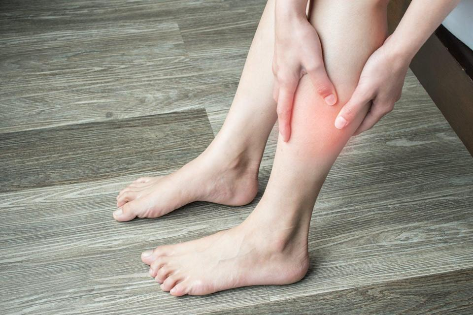 Person holding their leg in pain.