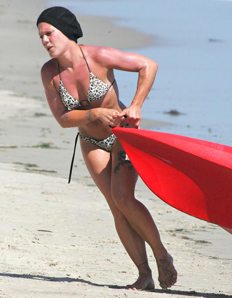1264549 Pop star Pink hit the waves once again in her Kayak in Malibu.  The singer is back to wearing her beanie cap after showing off some new platinum tresses just a few days ago.  After taking a wave pretty hard she called it a day and drug the small boat out of the ocean herself.  She then took a small break inside before reemerging in a leopard print bathing suit cover.  Throwing her hands in the air she took in the sun and stretched a bit.  Hopefully she also smothered herself in sun screen while inside because after spending so much time outside on the hot California day Pink was looking, well, pink! FameFlynet, Inc - Beverly Hills, CA, USA -  1 (818) 307-4813