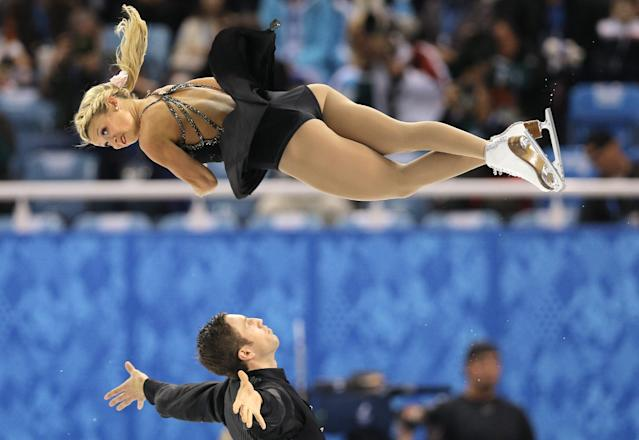 Kirsten Moore-Towers and Dylan Moscovitch of Canada compete in the pairs free skate figure skating competition at the Iceberg Skating Palace during the 2014 Winter Olympics, Wednesday, Feb. 12, 2014, in Sochi, Russia. (AP Photo/Vadim Ghirda)