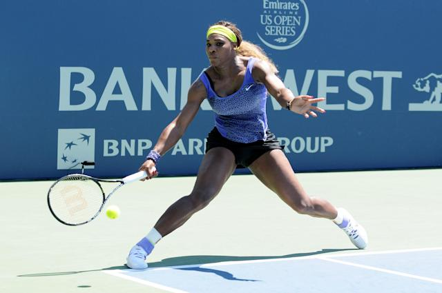Serena Williams hits a low shot against Andrea Petkovic during the Bank of the West Classic at the Taube Family Tennis Stadiumon August 2, 2014 in Stanford, California (AFP Photo/Noah Graham)