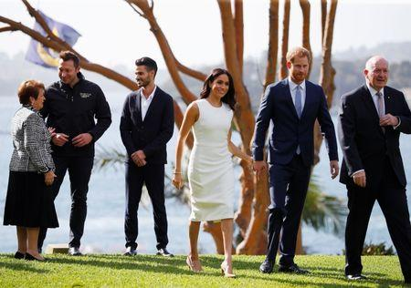 Britain's Prince Harry and wife Meghan, Duchess of Sussex walk with Australia's Governor General Peter Cosgrove and his wife Lynne Cosgrove at Admiralty House during their visit in Sydney, Australia October 16, 2018. REUTERS/Phil Noble/Pool